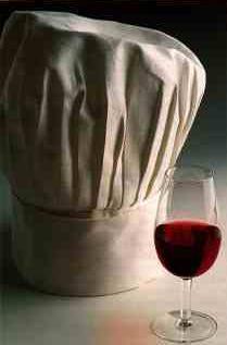 Taça de vinho e chapéu do Chef